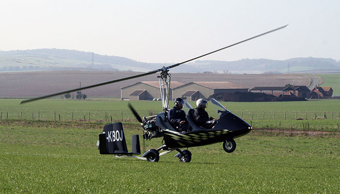 Kai Barennt flying next to frinds in his own gyro copter